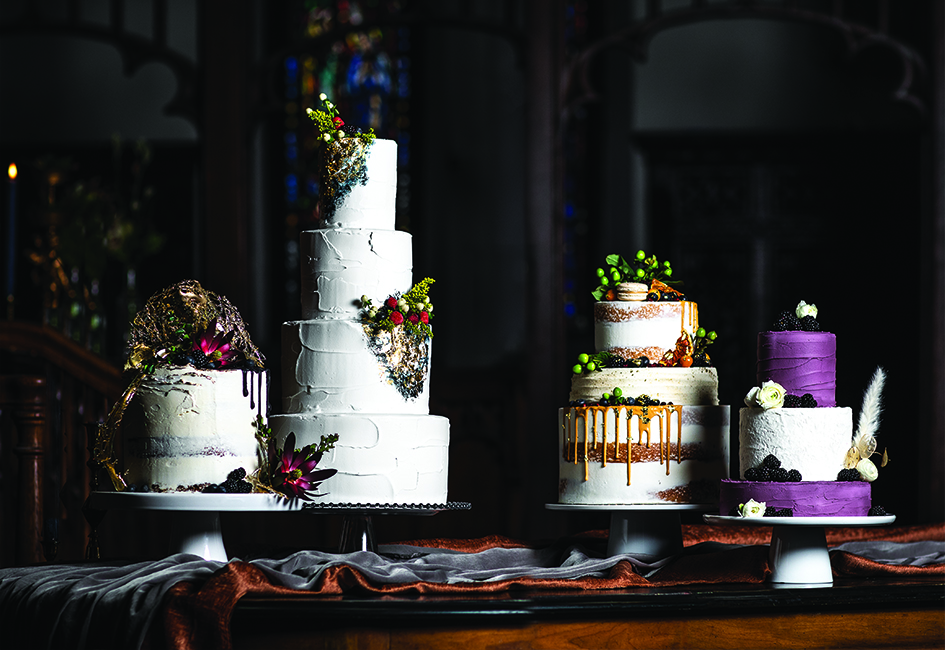 Four tiered wedding cakes with floral decorations and fruit toppings.