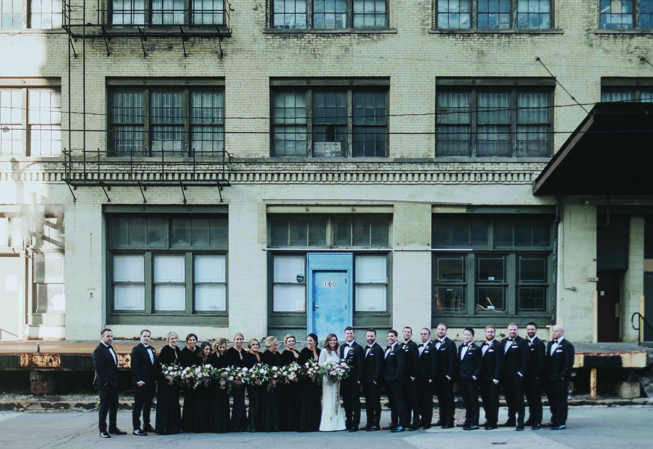 Danielle Kapitz and Michael Maletzke and their wedding party at the Black Swan Riverwalk, a Milwaukee wedding venue.