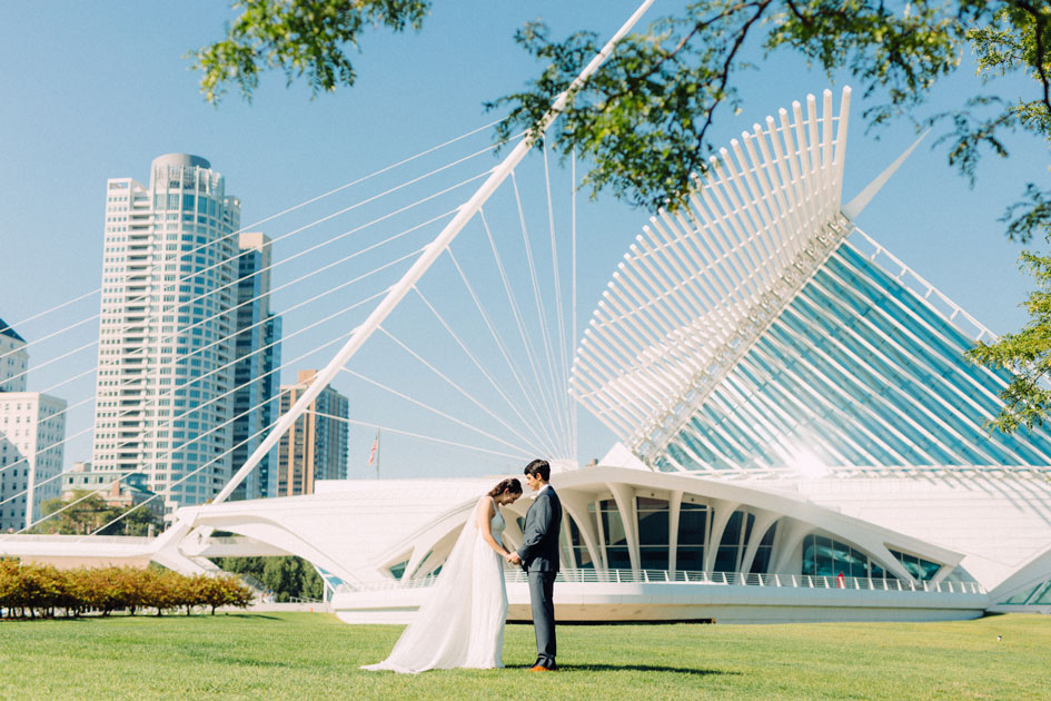 Bride and groom stand before the Quadracci Pavilion at the Milwaukee Art Museum