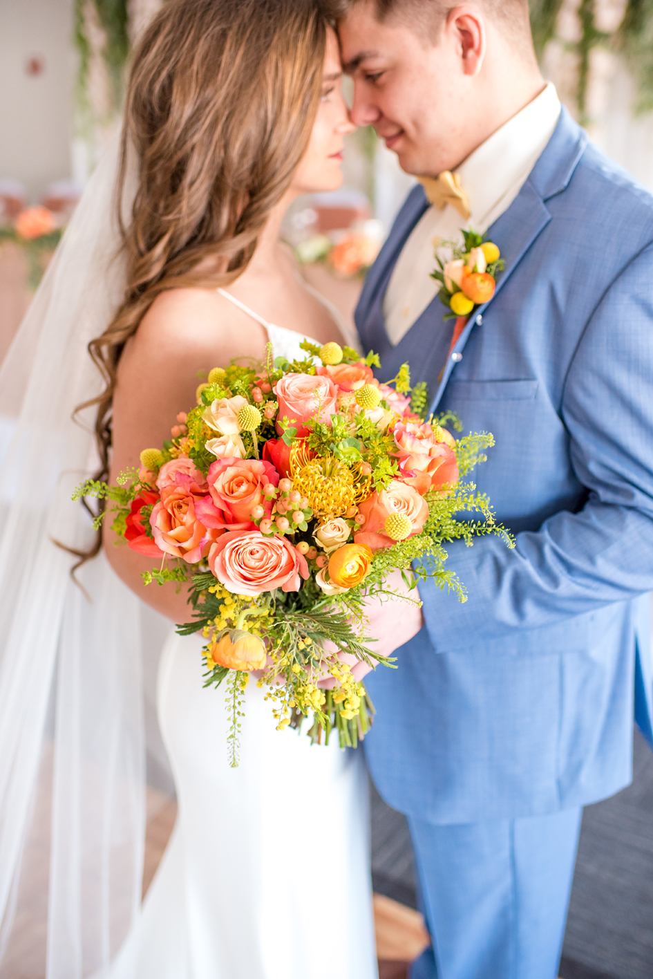 Couple shares a moment while holding a bright pink, orange and yellow bouquet at Par 4 Golf and Resort