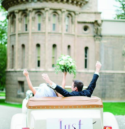 Cara Rosch and Alex Biholar leave the Yerkes Observatory in their Just Married car.