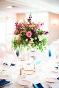A tall floral centerpiece at St. Anthony on the Lake, a premier Wisconsin wedding venue.