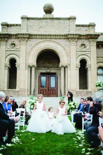 Three girls walk down the aisle at Yerkes Observatory.