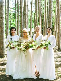 Ashley Zelenka and her bridesmaids pose at her rustic camp wedding.