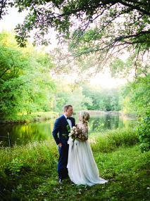 Ashley Zelenka and Evan Bohman pose at their rustic camp wedding.