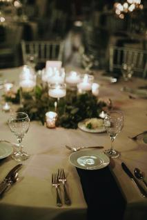 A candle centerpiece on a table at Black Swan Riverwalk, a Milwaukee wedding venue.