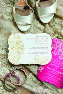 A details photo featuring the bride's jewelry, shoes and the wedding invitation.
