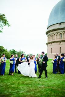 The wedding party poses for photos at the Yerkes Observatory.