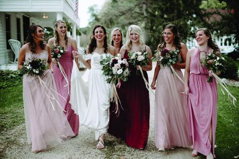 Caroline Grassl and her bridesmaids pose for a photo at her Sugarland Barn wedding.